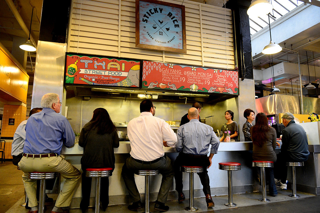 . People try out Sticky Rice at Grand Central Market in downtown Los Angeles Monday, April 30, 2013 during their grand opening. Sticky Rice, owned by David Tewasart, of Pasadena, is kicking off the openings of new restaurants at the market. (SGVN/Staff Photo by Sarah Reingewirtz)