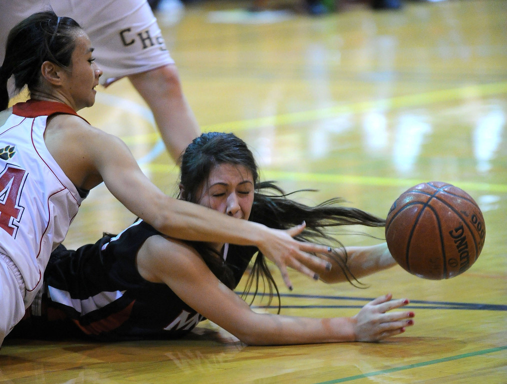 . Carondelet High\'s Amy Harioka (14, in white) and Monte Vista High\'s Rachel Tagle (4) battle for a loose ball in their high school basketball game played at Carondelet High School in Concord, Calif. on Friday, Feb. 1, 2013. (Dan Honda/Staff)