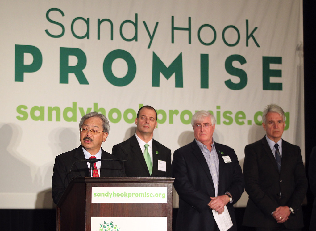 . San Francisco Mayor Ed Lee, far left, speaks as Lee Shull co-founder Sandy Hook Promise, Ron Conway special advisor to SV Angel, and San Francisco District Attorney George Gascón, from left, look on at a news conference to launch the Sandy Hook Promise Innovation Initiative held in honor of the three month anniversary of the tragic shooting at Sandy Hook Elementary School at the Bill Graham Civic Auditorium in San Francisco, Calif., on Thursday, March 14, 2013. (Anda Chu/Staff)