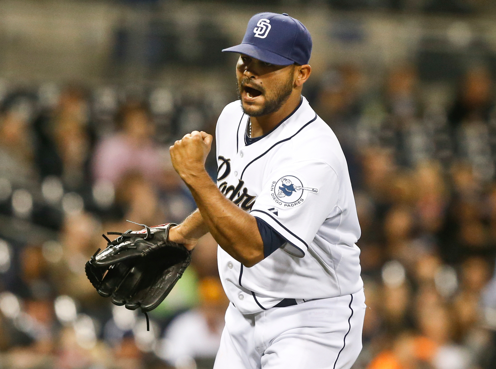 . San Diego Padres relief pitcher Alex Torres pumps his fist after getting Colorado Rockies\' Troy Tulowitzki to hit into an inning ending double play with two runners on base in the seventh inning of a baseball game Tuesday, April 15, 2014, in San Diego. (AP Photo/Lenny Ignelzi)