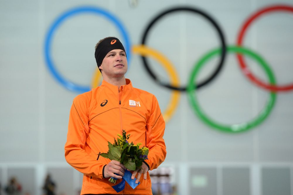 . Netherlands\' gold medalist Sven Kramer poses on the podium during the flower ceremony after in the Men\'s Speed Skating 5000m at the Adler Arena during the 2014 Sochi Winter Olympics on February 8, 2014.  (JUNG YEON-JE/AFP/Getty Images)