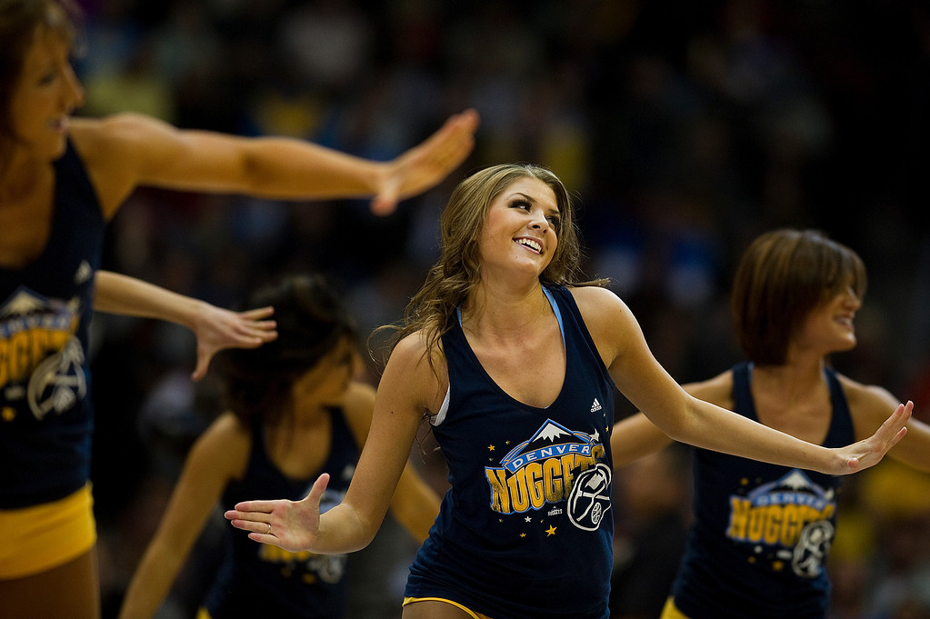 . DENVER, CO - DECEMBER 20: Dancers for the Denver Nuggets performs during a break in an NBA game against the Phoenix Suns at the Pepsi Center on December 20, 2013, in Denver, Colorado. The Suns won 103-99. (Photo by Daniel Petty/The Denver Post)