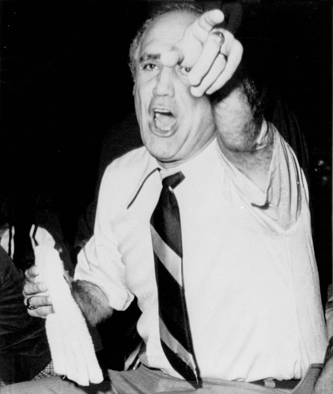 . University of Nevada-Las Vegas basketball coach Jerry Tarkanian yells instructions to his team during game in Las Vegas, March 24, 1977. (AP Photo)
