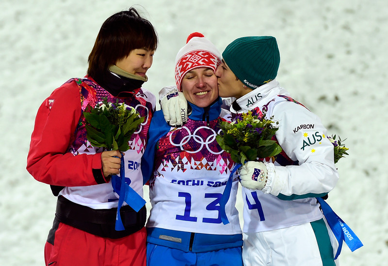 . (L-R) Silver Medallist, China\'s Xu Mengtao; Gold Medallist, Belarus\' Alla Tsuper; and Bronze Medallist, Australia\'s Lydia Lassila celebrate at the Women\'s Freestyle Skiing Aerials Flower Ceremony at the Rosa Khutor Extreme Park during the Sochi Winter Olympics on February 14, 2014.   (JAVIER SORIANO/AFP/Getty Images)