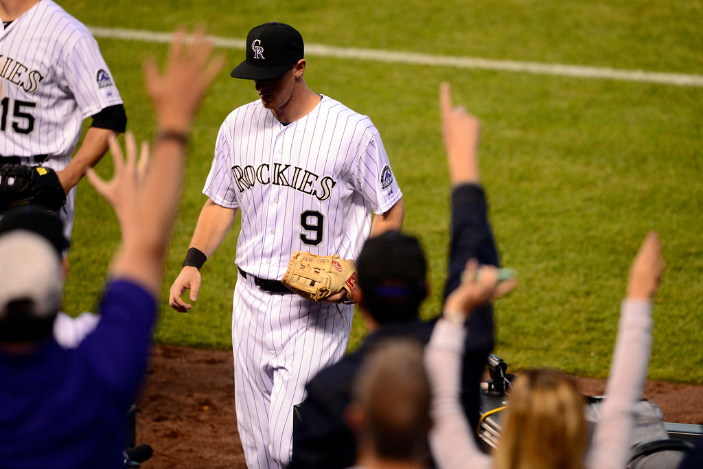 . DENVER, CO - MAY 21: Fans cheer DJ LeMahieu (9) of the Colorado Rockies after he made a play to get Gerardo Parra (8) of the Arizona Diamondbacks out during action at Coors Field. The Arizona Diamondbacks visited the Colorado Rockies. (Photo by AAron Ontiveroz/The Denver Post)