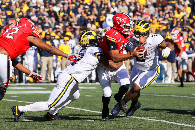 Michigan DE Aiden Hitchinson sacks Maryland QB Josh Jackson.