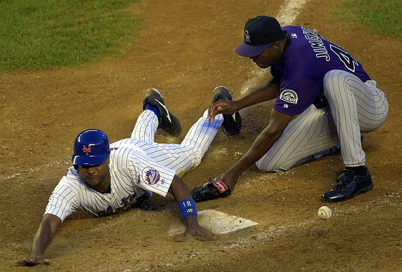 . Colorado Rockies pitcher Jose Jimenez, right, covers the plate after his wild pitch allowed New York Mets\' Darryl Hamilton to score in the seventh inning Tuesday, Aug. 15, 2000 at Shea Stadium in New York. (AP Photo/Lou Requena)