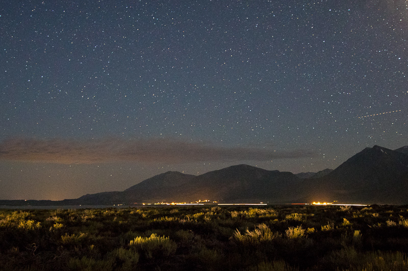 August 25 - Nighttime over the Sherwins and Highway 395, with the distant lights of Bishop.jpg