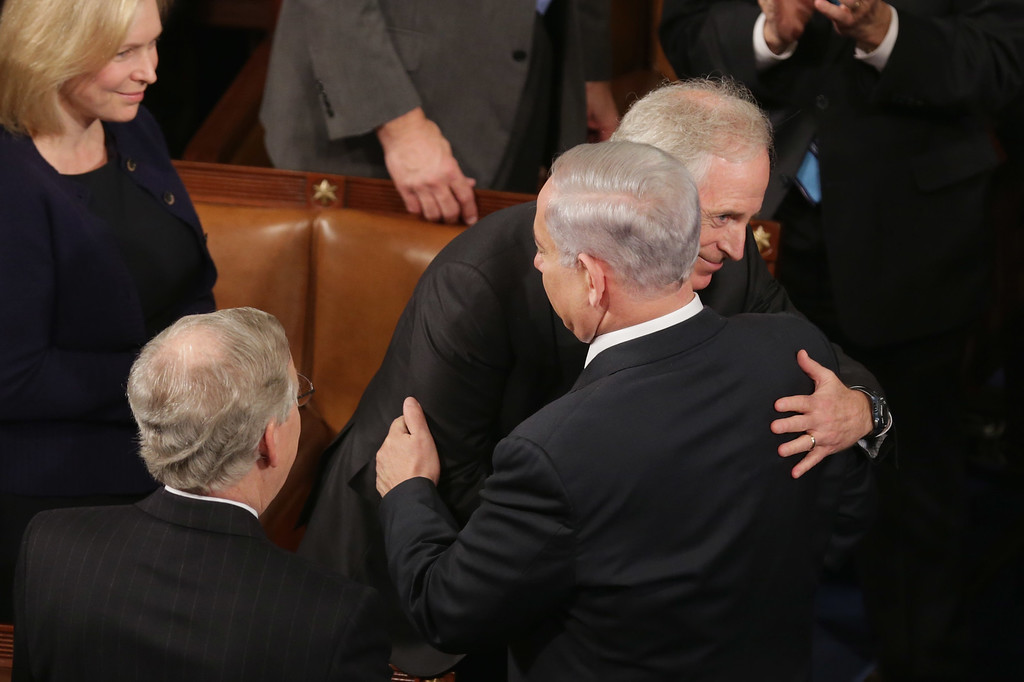 . Senate Foreign Relations Committee Chairman Bob Corker (D-TN) embraces Prime Minister Benjamin Netanyahu of Israel after he addressed a joint meeting of the United States Congress in the House chamber at the U.S. Capitol March 3, 2015 in Washington, DC. At the risk of further straining the relationship between Israel and the Obama Administration, Netanyahu warned members of Congress against what he considers an ill-advised nuclear deal with Iran.  (Photo by Chip Somodevilla/Getty Images)
