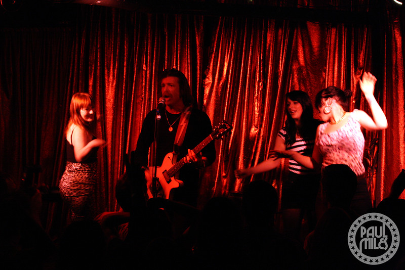 Cherry bar staff join Jesse Hughes on stage during his impromptu set in Melbourne, Australia during February 2010.