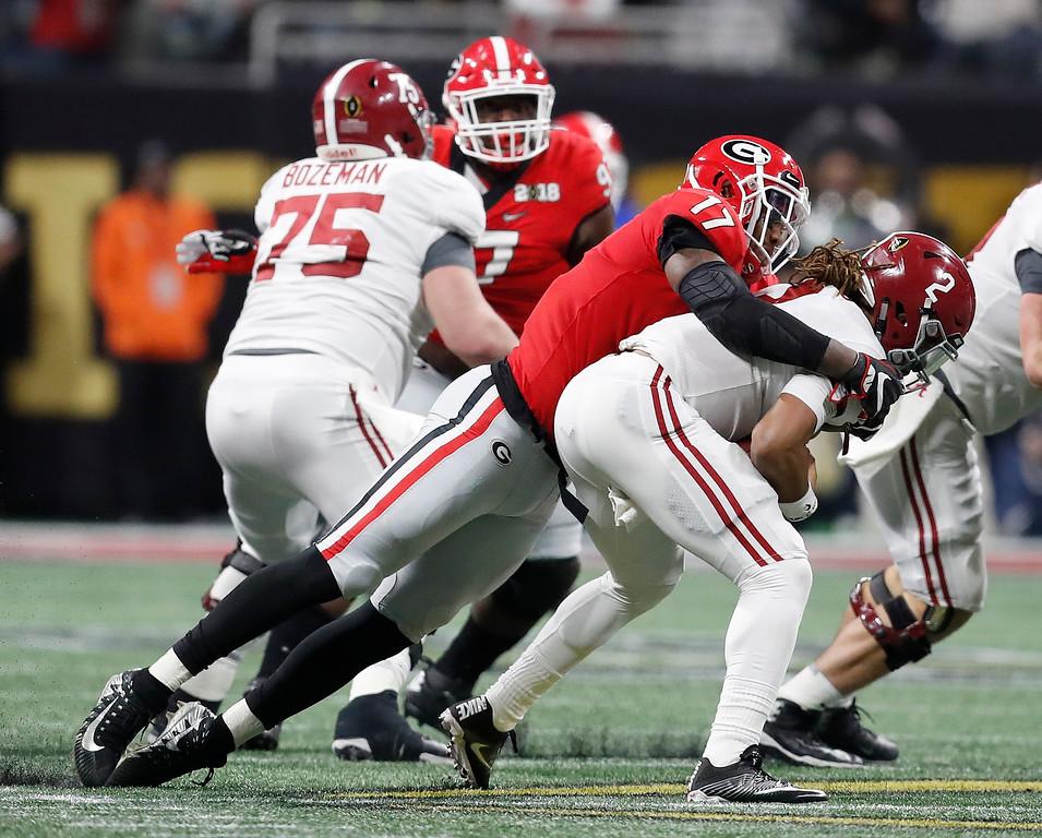 . Georgia linebacker Davin Bellamy Alabama quarterback Jalen Hurts during the first half of the NCAA college football playoff championship game Monday, Jan. 8, 2018, in Atlanta. (AP Photo/David Goldman)