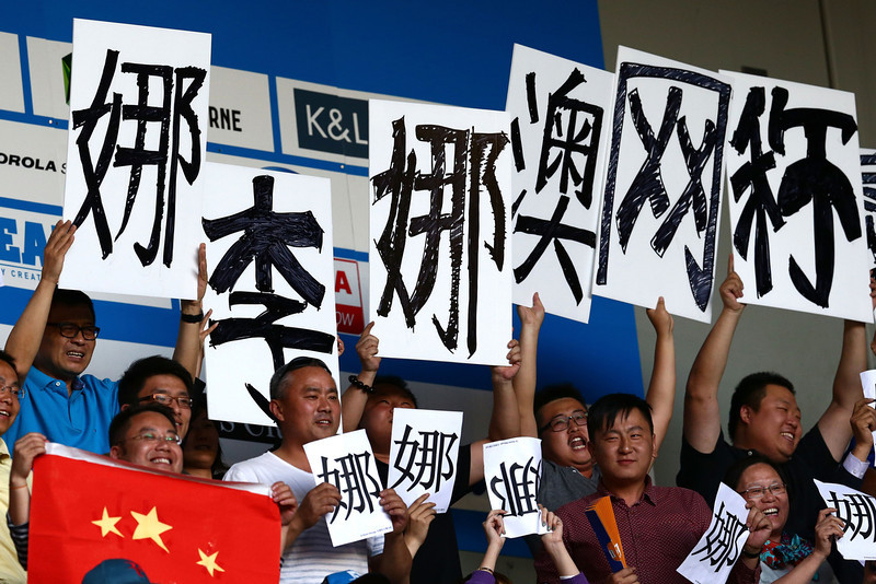 . Fans of Na Li of China watch her in her women\'s final match against Dominika Cibulkova of Slovakia during day 13 of the 2014 Australian Open at Melbourne Park on January 25, 2014 in Melbourne, Australia.  (Photo by Matt King/Getty Images)