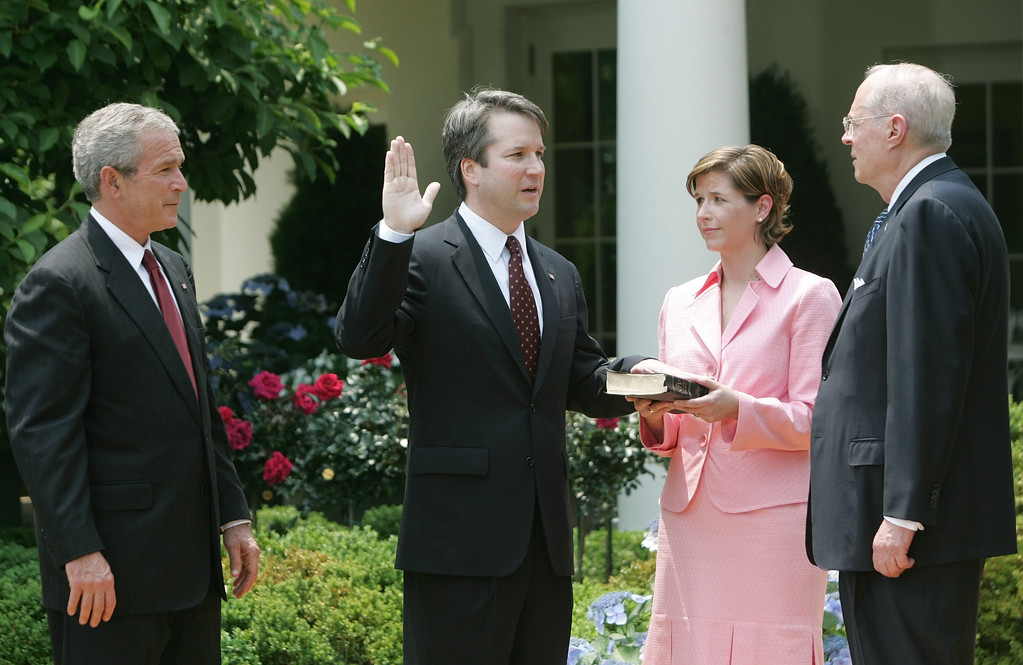 . From left to right, President Bush, watches the swearing-in of Brett Kavanaugh as Judge for the U.S. Court of Appeals for the District of Columbia by U.S. Supreme Court Associate Justice Anthony M. Kennedy, far right, during a ceremony in the Rose Garden of the White House, Thursday, June 1, 2006 in Washington. Holding the Bible is Kavanaugh\'s wife Ashley Kavanaugh. (AP Photo/Pablo Martinez Monsivais)