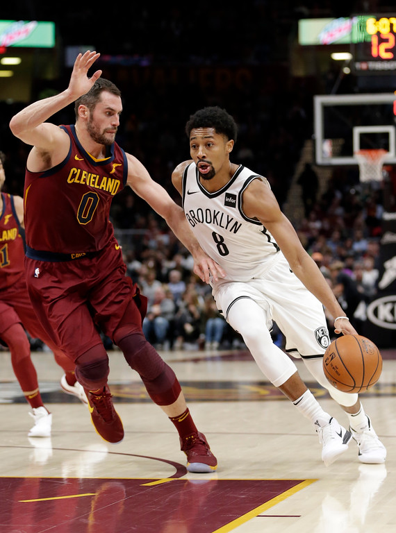 . Brooklyn Nets\' Spencer Dinwiddie (8) drives past Cleveland Cavaliers\' Kevin Love (0) during the first half of an NBA basketball game, Wednesday, Nov. 22, 2017, in Cleveland. (AP Photo/Tony Dejak)