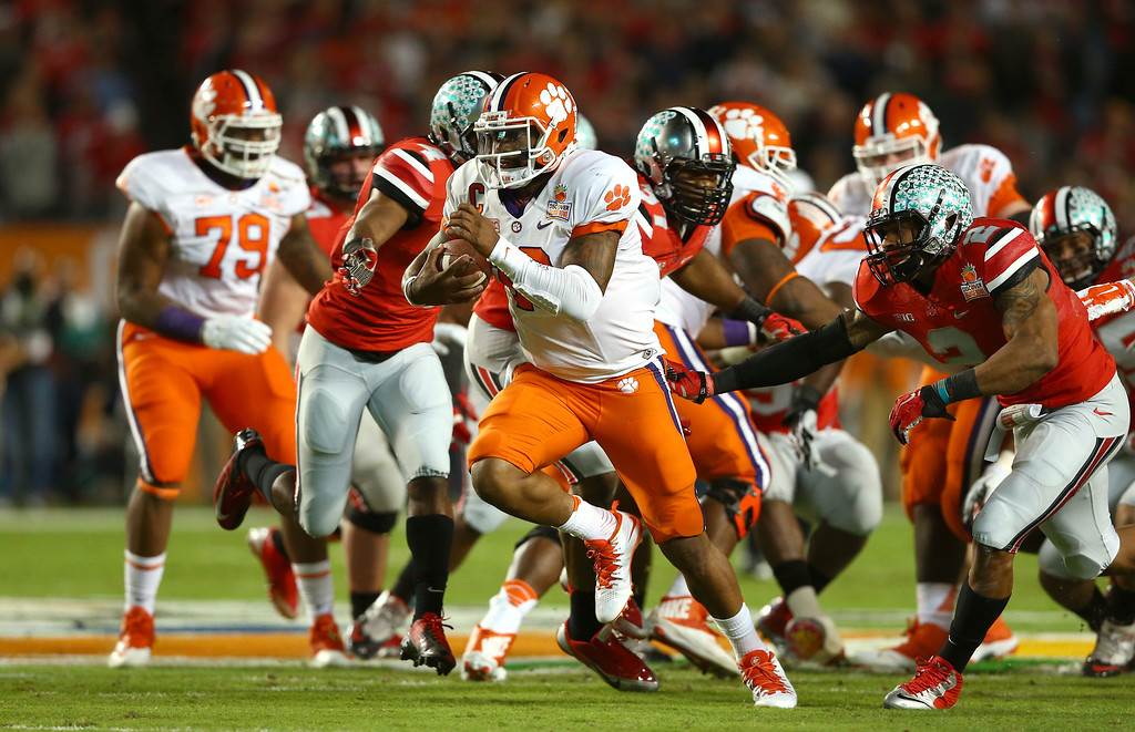 . MIAMI GARDENS, FL - JANUARY 03:  Tajh Boyd #10 of the Clemson Tigers runs for a touchdown in the first half against the Ohio State Buckeyes during the Discover Orange Bowl at Sun Life Stadium on January 3, 2014 in Miami Gardens, Florida.  (Photo by Streeter Lecka/Getty Images)