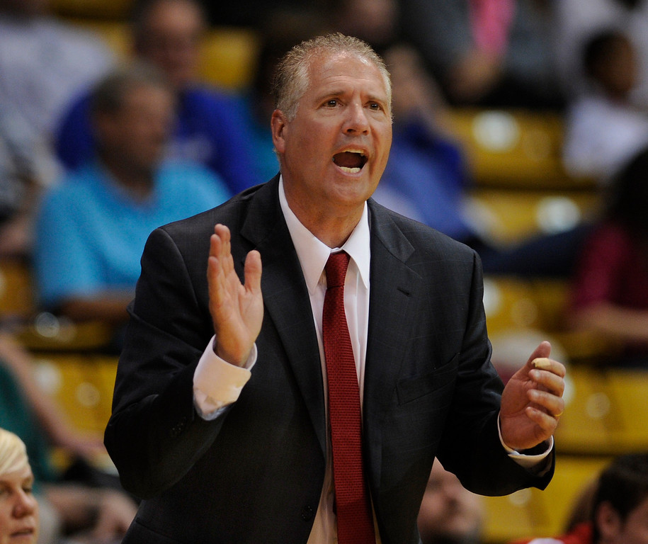 . BOULDER, CO. - MARCH 14: Raiders coach Carl Mattei encouraged the team from the bench. The Regis Jesuit High School girl\'s basketball team edged Grandview 46-43 Thursday night, March 14, 2013 at the Coors Events Center in Boulder.  (Photo By Karl Gehring/The Denver Post)