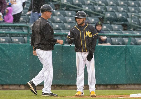 05/03/19 Wesley Bunnell | Staff The New Britain Bees home opener vs the Somerset Patriots on Friday night at New Britain Stadium. Short stop Alexi Amarista (2) fist bumps third base coach and hitting coach Chuck Stewart.