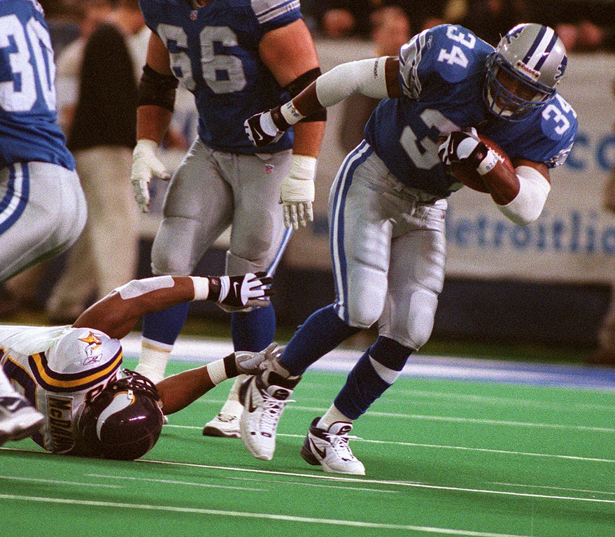 . Detroit Lions\' running back James Stewart (right) leaves Minnesota linebacker Ed McDaniel on the ground as he breaks away from the tackle to gain yardage  during theLions\' 27-24 victory over the Minnesota Vikings at the Silverdome Sunday.  The Lions are now 1-12.