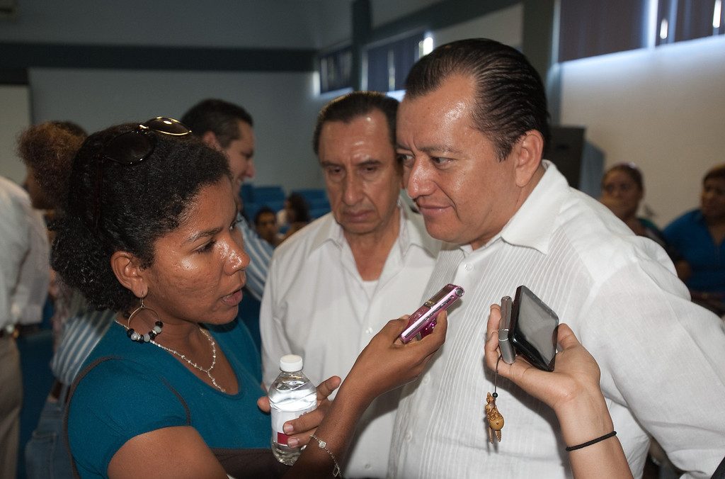 . Mexican journalists are under siege throughout the country both from organized crime and abusive government authorities. Reporters and photographers at El Sur newspaper in Acapulco take various precautions to deal with the threats they receive. On daily assignment covering education stories, El Sur de Acapulco reporter Aurora Harrison interviews the head of the Autonomous University of Guerrero after he presented computers to indigenous medical students. (Keith Dannemiller/MCT)