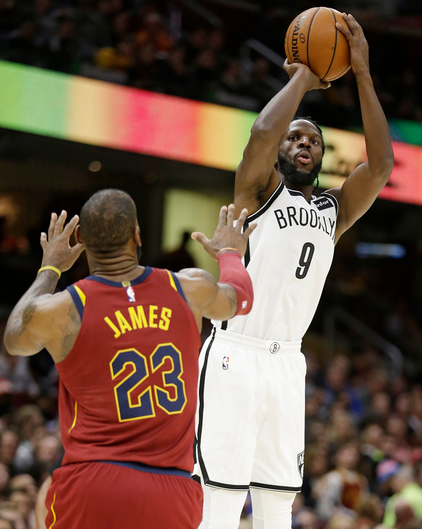 . Brooklyn Nets\' DeMarre Carroll (9) shoots over Cleveland Cavaliers\' LeBron James (23) in the first half of an NBA basketball game, Wednesday, Nov. 22, 2017, in Cleveland. (AP Photo/Tony Dejak)