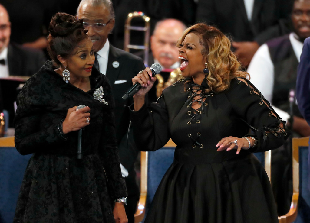 . The Clark sisters, Dorinda Clark Cole, left, and Karen Clark Sheard perform during the funeral service for Aretha Franklin at Greater Grace Temple, Friday, Aug. 31, 2018, in Detroit. Franklin died Aug. 16, 2018 of pancreatic cancer at the age of 76. (AP Photo/Paul Sancya)