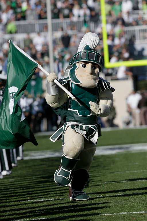 . Sparty, the Michigan State mascot is seen during the first half of an NCAA college football game against Michigan in East Lansing, Mich., Saturday, Oct. 25, 2014. (AP Photo/Carlos Osorio)