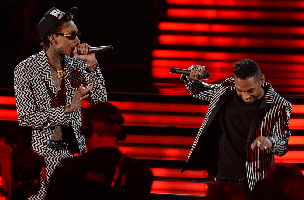 Description of . Rapper Wiz Khalifa and singer Miguel perform onstage at the 55th Annual GRAMMY Awards at Staples Center on February 10, 2013 in Los Angeles, California.  (Photo by Kevork Djansezian/Getty Images)