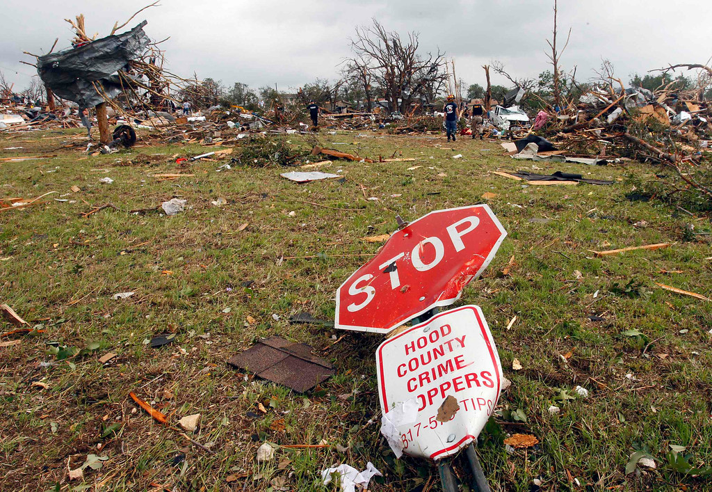 . A stop sign lies among debris May 16 after tornados swept through the town of Granbury, Texas late May 15, 2013. REUTERS/Richard Rodriguez