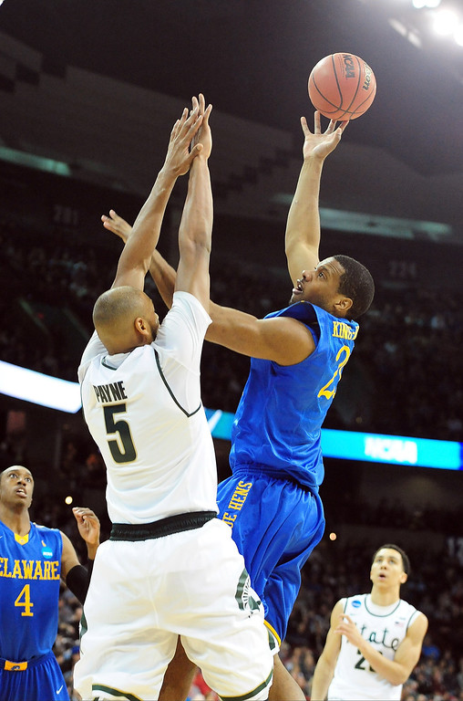 . Marvin King-Davis #21 of the Delaware Fightin Blue Hens shoots over Adreian Payne #5 of the Michigan State Spartans during the second round of the 2014 NCAA Men\'s Basketball Tournament at Spokane Veterans Memorial Arena on March 20, 2014 in Spokane, Washington.  (Photo by Steve Dykes/Getty Images)