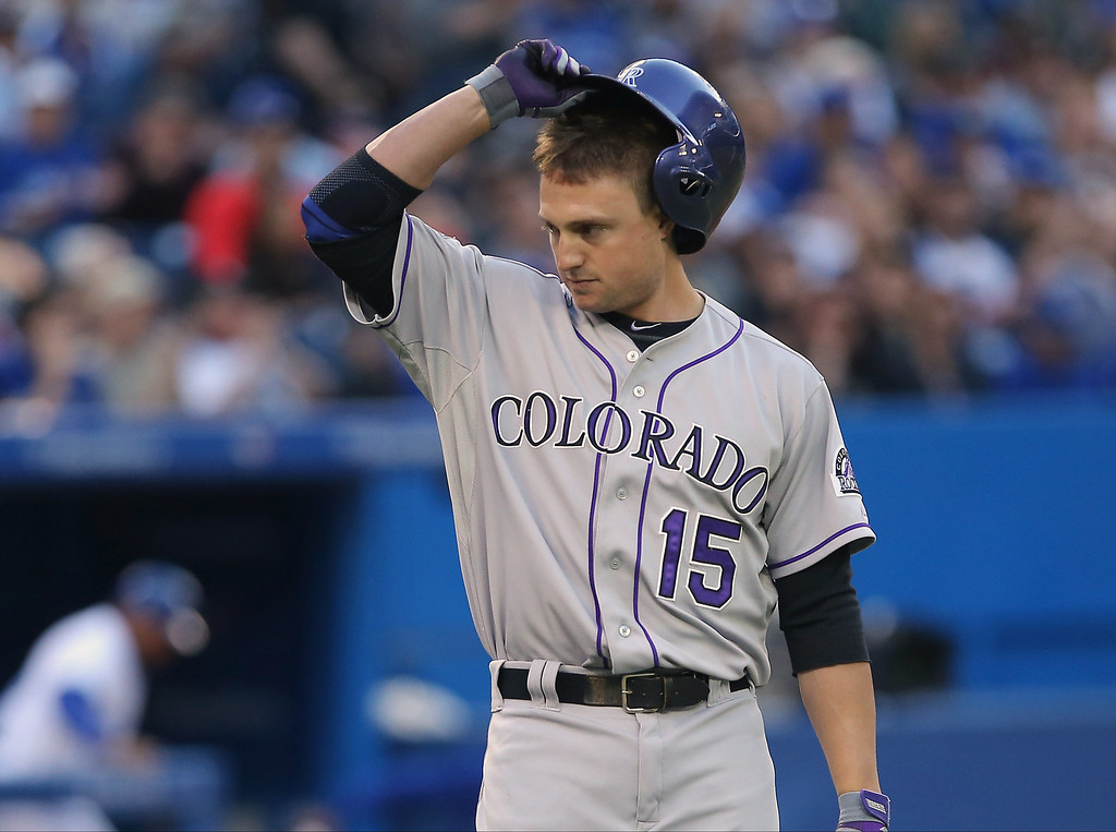 . Jordan Pacheco #15 of the Colorado Rockies reacts after striking out to end the third inning during MLB game action against the Toronto Blue Jays on June 19, 2013 at Rogers Centre in Toronto, Ontario, Canada. (Photo by Tom Szczerbowski/Getty Images)