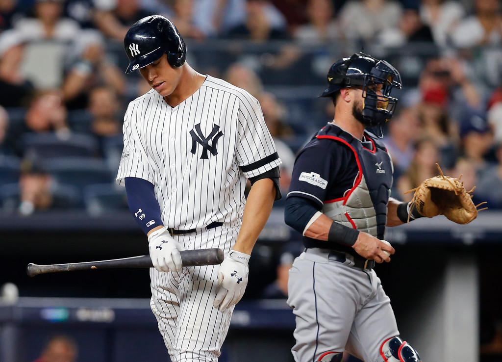 . New York Yankees\' Aaron Judge, left, reacts after striking out against the Cleveland Indians during the eighth inning in Game 3 of baseball\'s American League Division Series, Sunday, Oct. 8, 2017, in New York. (AP Photo/Kathy Willens)