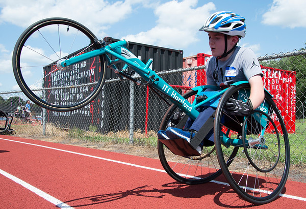 08/08/19 Wesley Bunnell | Staff Max Gilmore leans back in his racing wheel chair during warm ups for the track and field event at the Hospital for Special Care's Ivan Lendl Adaptive Sports Camp at Berlin High School on Thursday August 9, 2019.