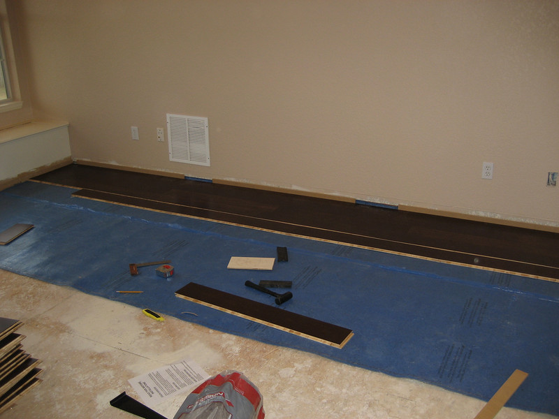 Laying floor in main room.