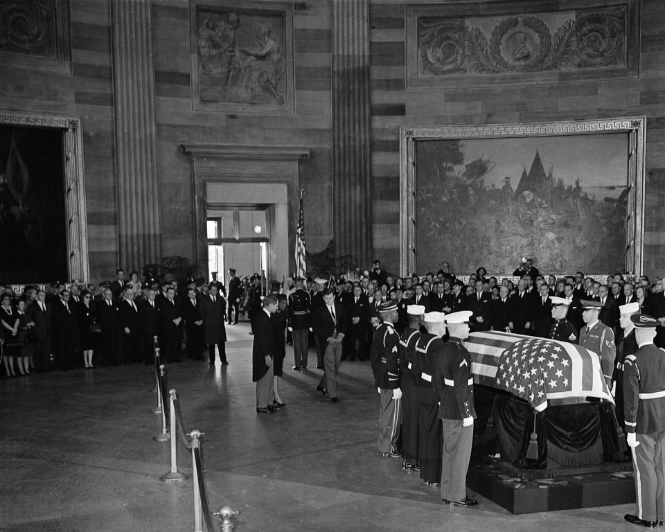 . Jacqueline Kennedy, flanked by Attorney General Robert F. Kennedy, left,  and Sen. Edward M. Kennedy, backs away from the casket in the Capitol rotunda Nov. 25, 1963.   Associated Press file