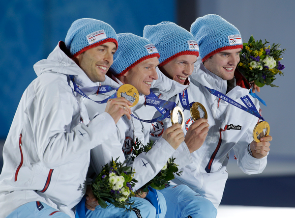 . The team from Norway, who won the gold medal in the team Gundersen large hill Nordic combined competition, pose with their medals  at the 2014 Winter Olympics, Thursday, Feb. 20, 2014, in Sochi, Russia. (AP Photo/Morry Gash)
