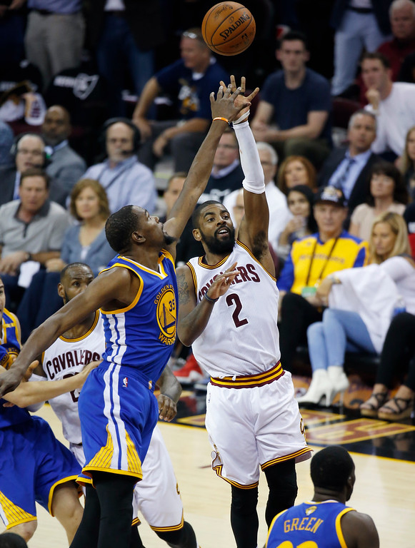 . Cleveland Cavaliers guard Kyrie Irving (2) shoots next to Golden State Warriors forward Kevin Durant (35) in the first half of Game 4 of basketball\'s NBA Finals in Cleveland, Friday, June 9, 2017. (AP Photo/Ron Schwane)