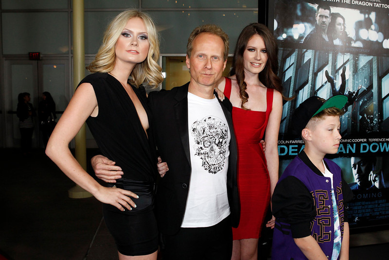 """. Danish director Niels Arden Oplev poses with his children (L-R) Anna, Linea, and Thoreau at the premiere of his new film \""""Dead Man Down\"""" in Hollywood February 26, 2013. REUTERS/Fred Prouser"""