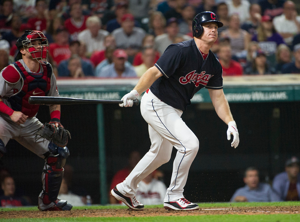 . Cleveland Indians\' Jay Bruce watches a foul ball along with Boston Red Sox\' Christian Vasquez during the eight inning of a baseball game in Cleveland, Monday, Aug. 21, 2017. The Indians won 5-4. (AP Photo/Phil Long)