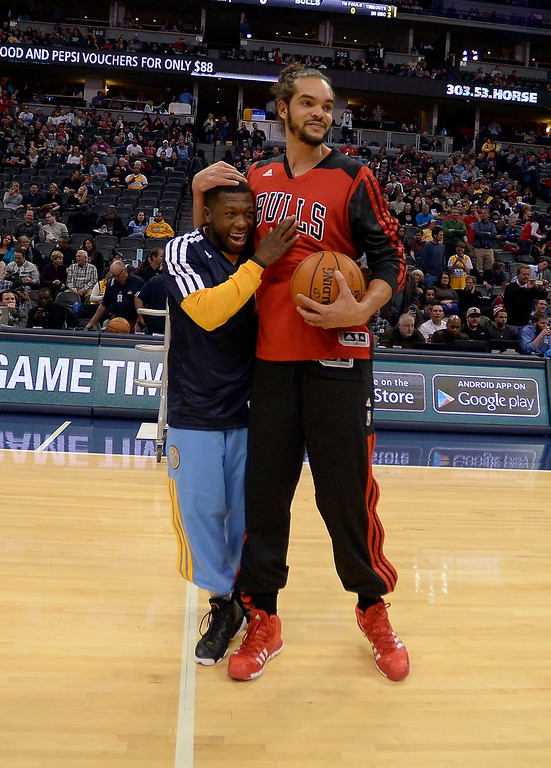 . Denver Nuggets point guard Nate Robinson (10) gets a hug from Chicago Bulls center Joakim Noah (13) during pre game November 21, 2013 at Pepsi Center. (Photo by John Leyba/The Denver Post)
