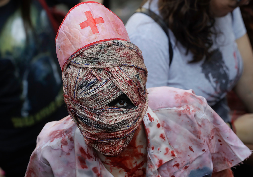 . A participant in zombie costume takes part in the Zombie Walk in Sao Paulo, Brazil, Thursday, Nov. 2, 2017. Participants commemorated the Day of the Dead with the annual Zombie Walk. (AP Photo/Andre Penner)