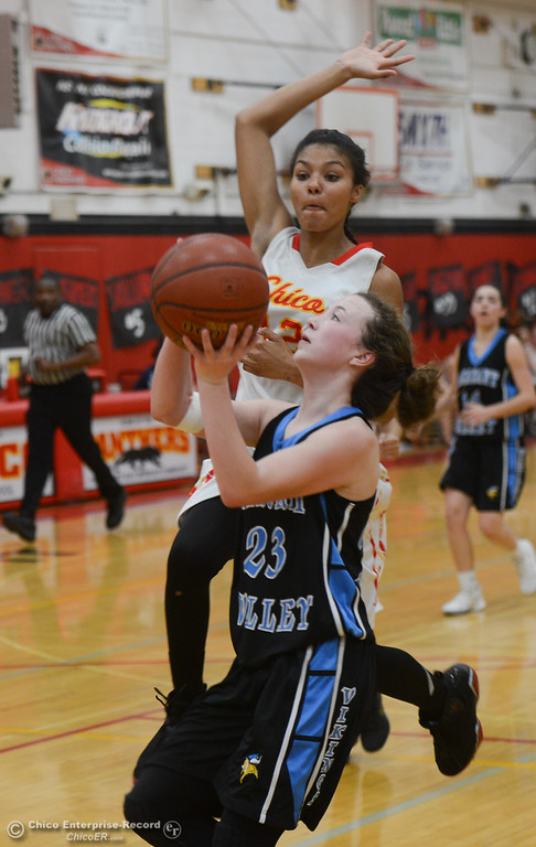 . Pleasant Valley\'s Adrianie Servin-Smith (23) goes up for a shot against Chico High\'s Tamara Haley (12), Thursday, February 8, 2018, in Chico, California. (Carin Dorghalli -- Enterprise-Record)