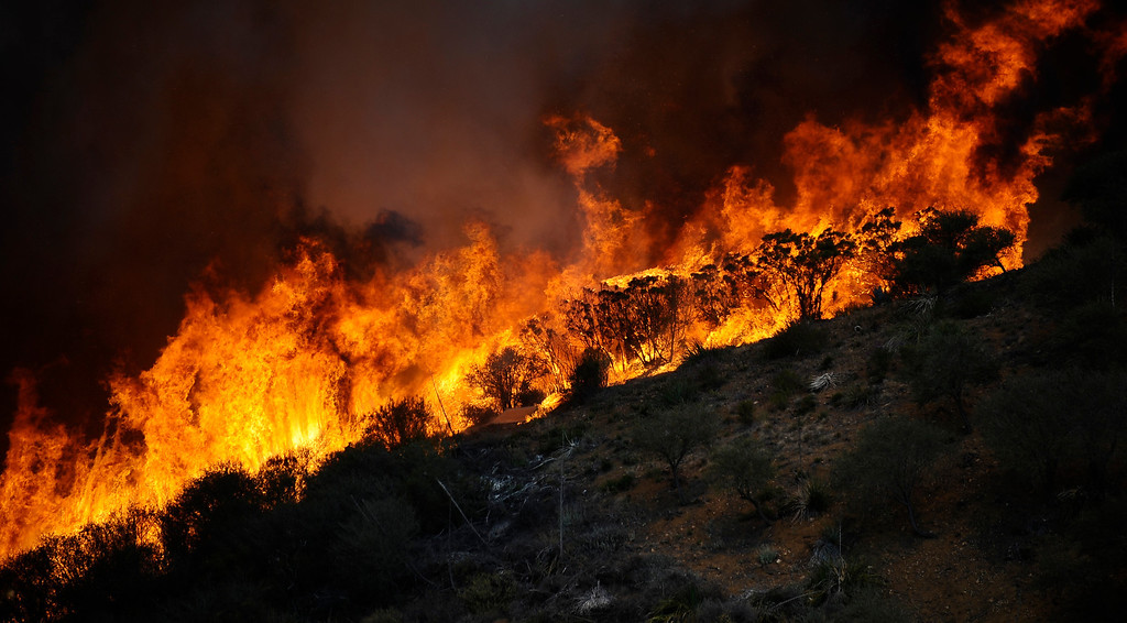 . Huge flames race across  the canyon areas during the second day of the Springs Fire in the mountain areas of Ventura County CA.  May 3, 2013. A fierce, wind-whipped brush fire spread on Friday along the California coast northwest of Los Angeles, threatening several thousand homes and a military base as more than 1,100 dwellings were ordered evacuated and a university campus was closed. May 2,2013. Ventura County California.  Photo by Gene Blevins/LA Daily News