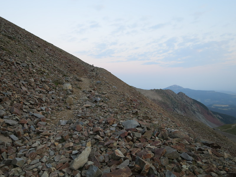 Cairn beckoning up ahead - lots of talus, so just get over it.