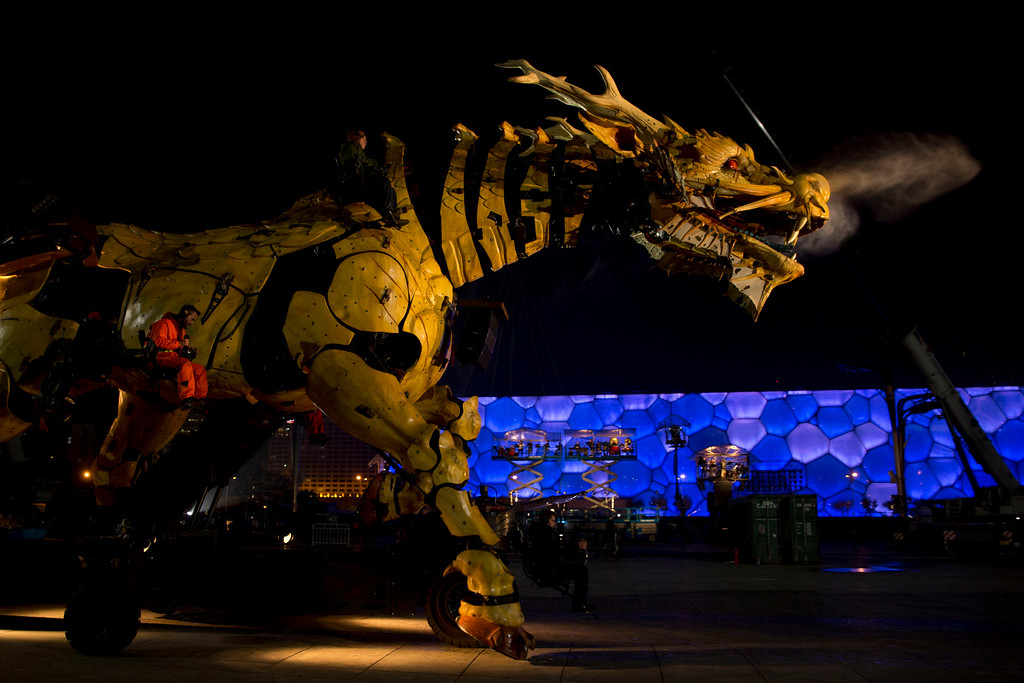 . French production company La Machine\'s latest creation the Long Ma or Dragon Horse goes through rehearsals in front of the Water Cube or National Aquatics Center in Beijing, China, Thursday, Oct. 16, 2014. The three days performances mark the climax of celebrations for the 50th anniversary of Sino-French diplomatic relations on Sunday, Oct 19. (AP Photo/Ng Han Guan)