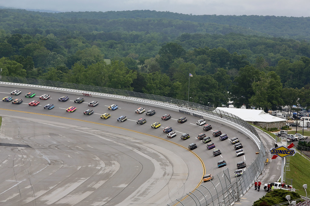 . TALLADEGA, AL - MAY 04:  A pack of cars drive through a turn during the NASCAR Nationwide Series Aaron\'s 312 at Talladega Superspeedway on May 4, 2013 in Talladega, Alabama.  (Photo by Jerry Markland/Getty Images)