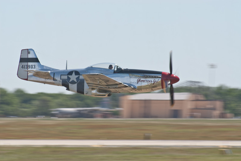 """Dale """"Snort"""" Snodgrass with the P-51D Mustang on Runway 19"""