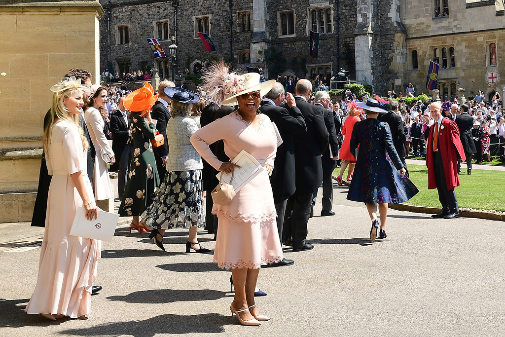 . Oprah Winfrey leaves St George\'s Chapel at Windsor Castle after the wedding of Meghan Markle and Prince Harry,  in Windsor Castle in Windsor, near London, England, Saturday, May 19, 2018. (Ian West/pool photo via AP)
