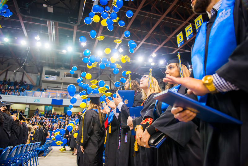 Balloons drop from the ceiling at the end of UAF's commencement ceremony in the Carlson Center on May 5, 2018.