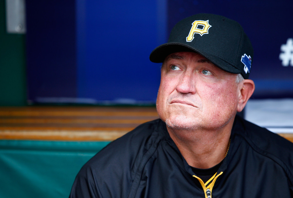 . Manager Clint Hurdle #13 of the Pittsburgh Pirates looks on in the dugout prior to Game Four of the National League Division Series against the St. Louis Cardinals at PNC Park on October 7, 2013 in Pittsburgh, Pennsylvania.  (Photo by Jared Wickerham/Getty Images)
