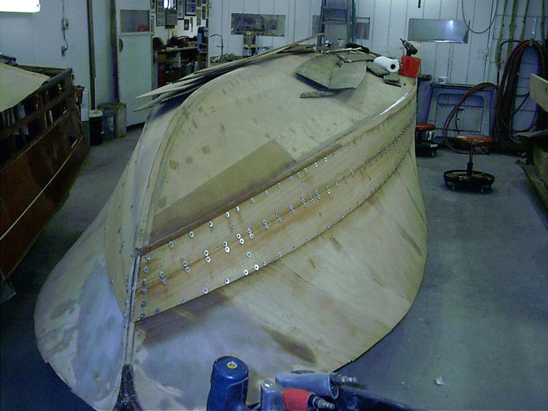 Starboard front view of first two planks glued in place.